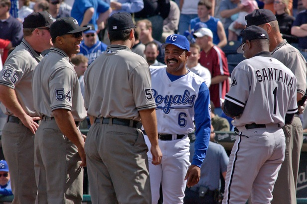 Royals manager talks to umpires before the game.